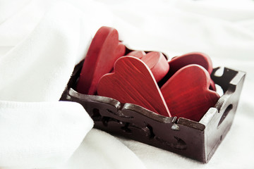 box full of red valentine's hearts with white towels