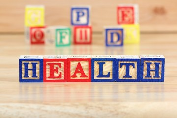 Health - wooden toy block letter concept