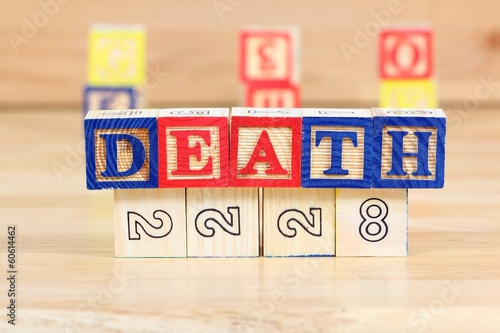 Child death - wooden toy block letter concept