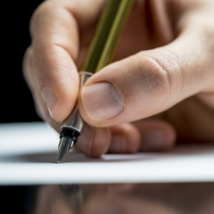 Man writing with a fountain pen