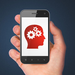 Advertising concept: Head With Gears on smartphone