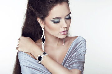 Beautiful brunette woman with jewelry fashion accessories. Make-
