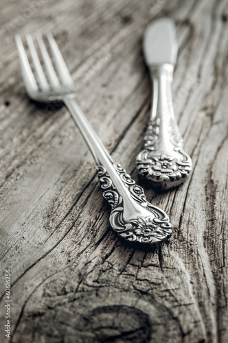 old cutlery on wooden table