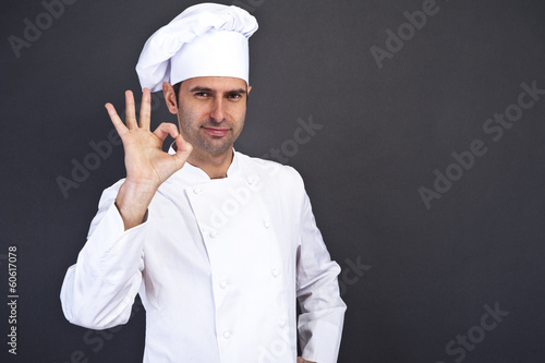 portriat of the cook over dark background