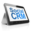 Business concept: Social CRM on tablet pc computer