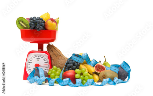 kitchen scales, fruits and measuring tape isolated on white back