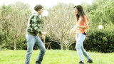Couple in love in park playing and laughing