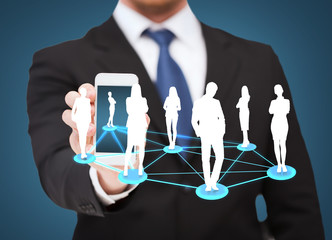 businessman showing smartphone with social network