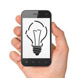 Business concept: Light Bulb on smartphone
