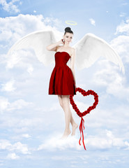 Beautiful brunette woman as cupid with heart made of roses