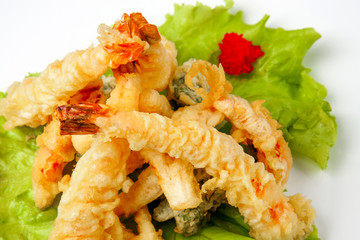 tiger prawns in tempura with lettuce leaves