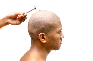 Thai man gets his head shaved.