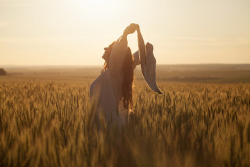 Happy woman with a shawl in field