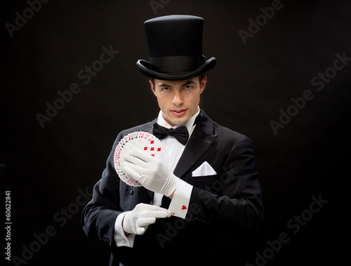 magician showing trick with playing cards