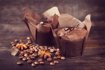 Muffin cakes with chocolate, spices and coffee grain