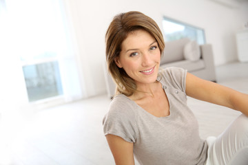 Smiling attractive woman relaxing at home