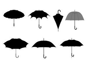 Black silhouettes of umbrellas on white background, vector