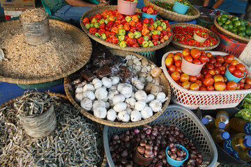 Fresh vegetables and dry fish at a market