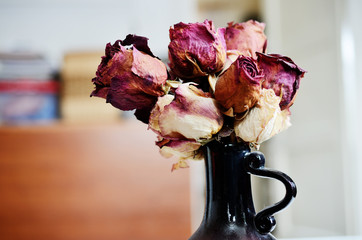 bouquet of dried roses in vase