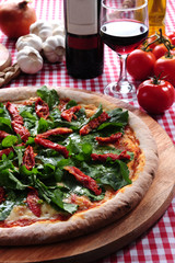 Pizza of arugula and sundried tomatoes