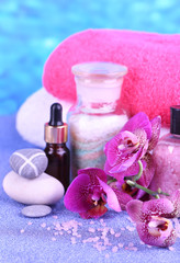 Beautiful spa setting with orchid on blue background