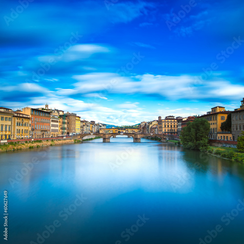 Santa Trinita and Old Bridge on Arno river, sunset landscape. Fl