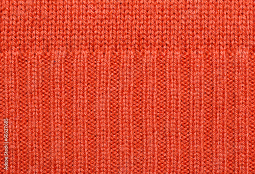 Red knitted fabric texture. Abstract background.