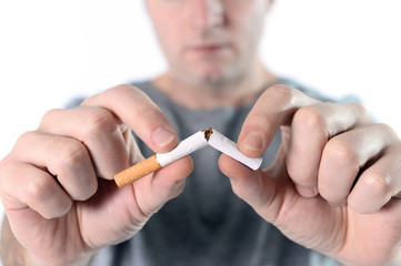 man breaking cigarette representing quit smoking