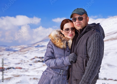 Happy family in winter mountains