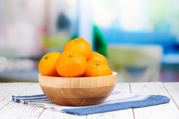 Ripe sweet tangerines with spices in bowl,
