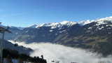 Gondola lift above the fog in valley, Alps, Zillertal, Austria