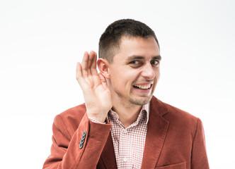 Man listens. Hand near ear.