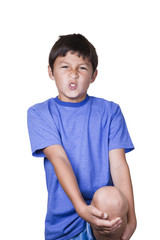 Young boy with hurt sprained knee - on white background