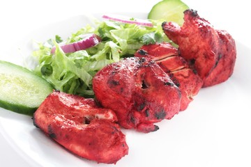 chicken tikka kebab with salad