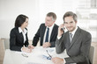 Leinwanddruck Bild - Businessman at phone in meeting