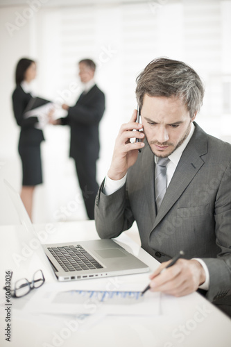 Businessman at phone in meeting
