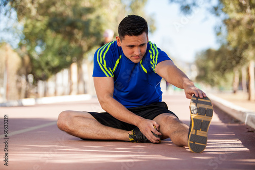 Young athlete stretching
