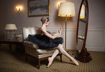 Ballerina taking self portrait with camera on her cell phone