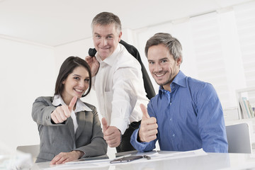 business team at office showing thumb up