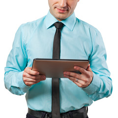 Businessman using a tablet computer - isolated