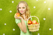 Attractive girl with basket of apples