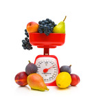 Fruit and kitchen scale on white background