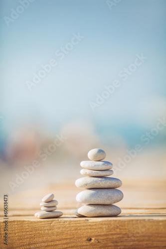 zen stones jy wooden banch on the beach near sea. Outdoor Canvas-taulu