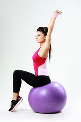 sport woman stretching on fitball
