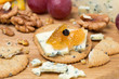 crackers with blue cheese and apple jam, nuts and grapes