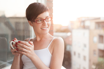 Women having a cup of coffee on balcony