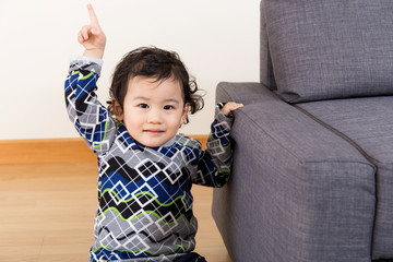 Asian baby finger pointing up