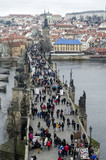 Tourists walk along the Charles Bridge