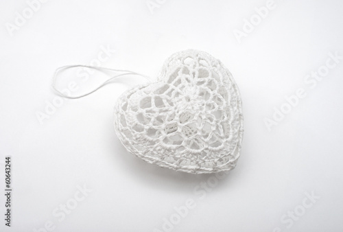 white heart made ​​of thread