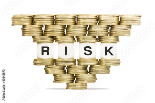 Risk Management Word Risk on Unstable Stack of Gold Coins